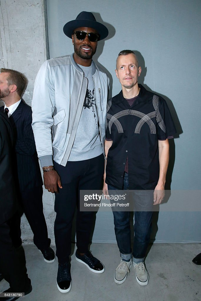 Basket-ball player Serge Ibaka and Stylist Lucas Ossendrijver attend the Lanvin Menswear Spring/Summer 2017 show as part of Paris Fashion Week on June 26, 2016 in Paris, France.