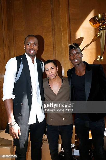 Basketball Player Serge Ibaka Fashion Designer Olivier Rousteing and Football Player Paul Pogba pose Backstage after the Balmain Menswear...