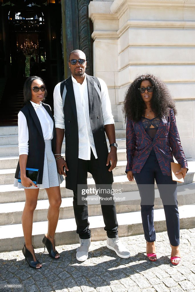 Basketball Player Serge Ibaka, his wife (L) and Guest attend the Balmain Menswear Spring/Summer 2016 show as part of Paris Fashion Week on June 27, 2015 in Paris, France.