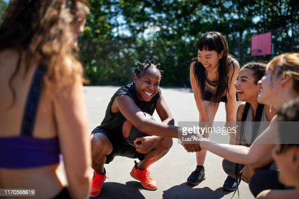 basketball player shaking hands during a game plan - sports league stock pictures, royalty-free photos & images