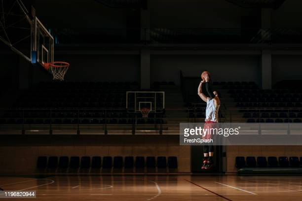 basketball player shooting - shooting baskets stock pictures, royalty-free photos & images