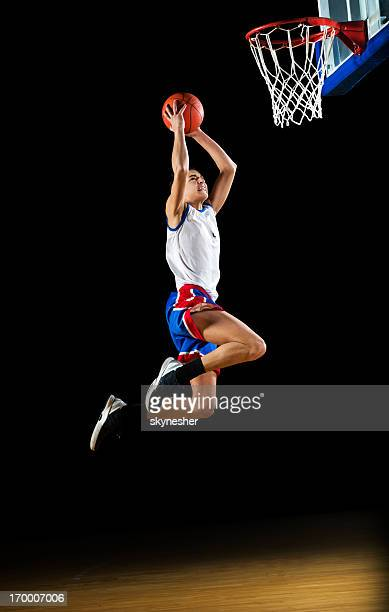 basketball player slam dunking the ball. - shooting baskets stock photos and pictures