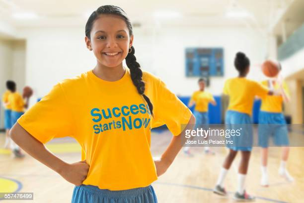 Basketball player smiling during practice in gym