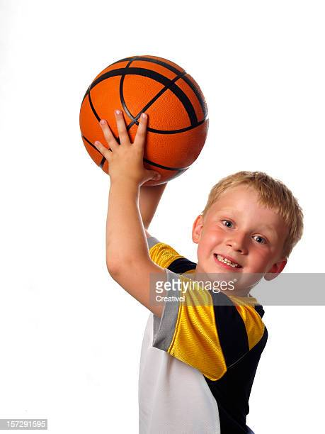 Basketball player, smiling little boy,  isolated on white