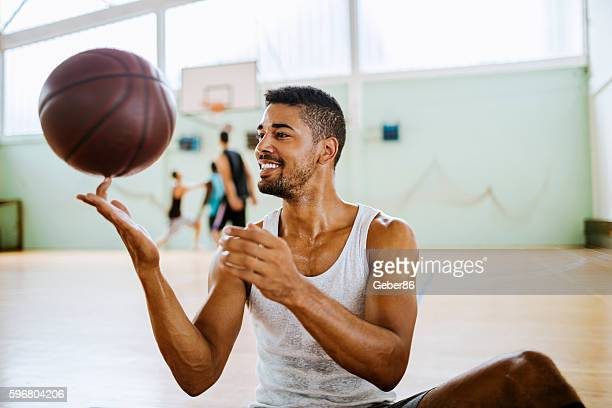 Basketball player spining a ball on his finger