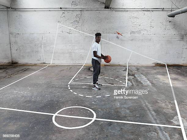 Basketball player standing on basketball court
