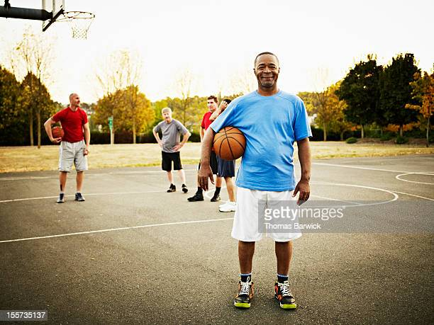 Basketball player standing on outdoor court