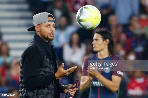 US basketball player Stephen Curry catches a ball flanked by Paris SaintGermain's Uruguayan forward Edinson Cavani prior to the start of the French...