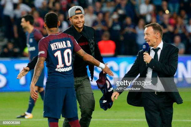 US basketball player Stephen Curry taps hands with Paris SaintGermain's Brazilian forward Neymar at the start of the French L1 football match between...