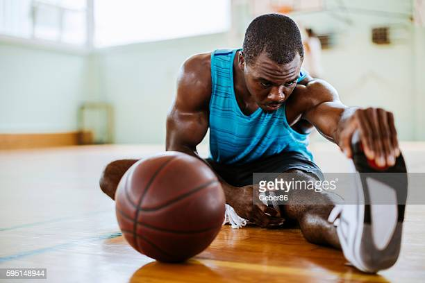 Basketball player stretching