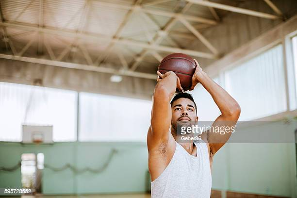 basketball player taking a shot - shooting baskets stock pictures, royalty-free photos & images