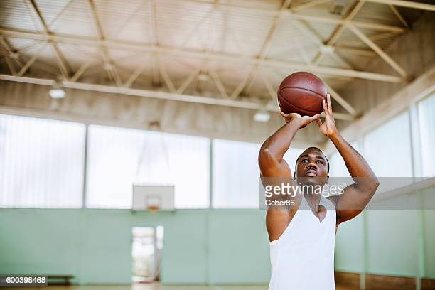 basketball player taking a shot - taking a shot sport stock pictures, royalty-free photos & images