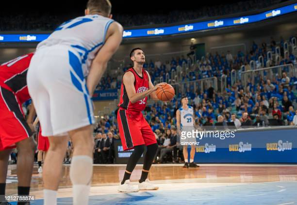 basketball player taking penalty shot - basketball player stock pictures, royalty-free photos & images