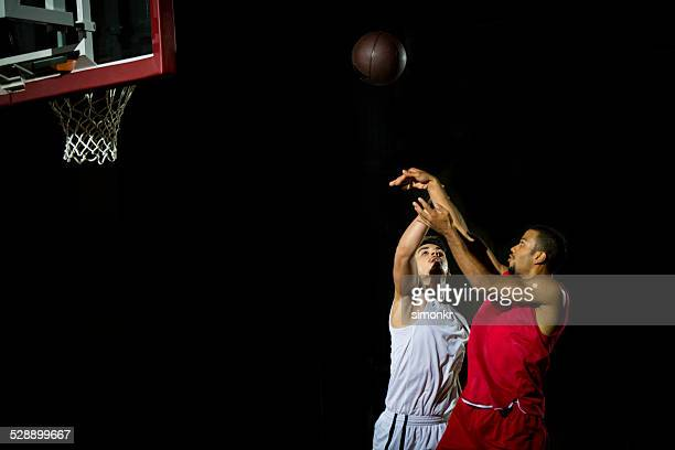 basketball player throwing a ball - shooting baskets stock pictures, royalty-free photos & images
