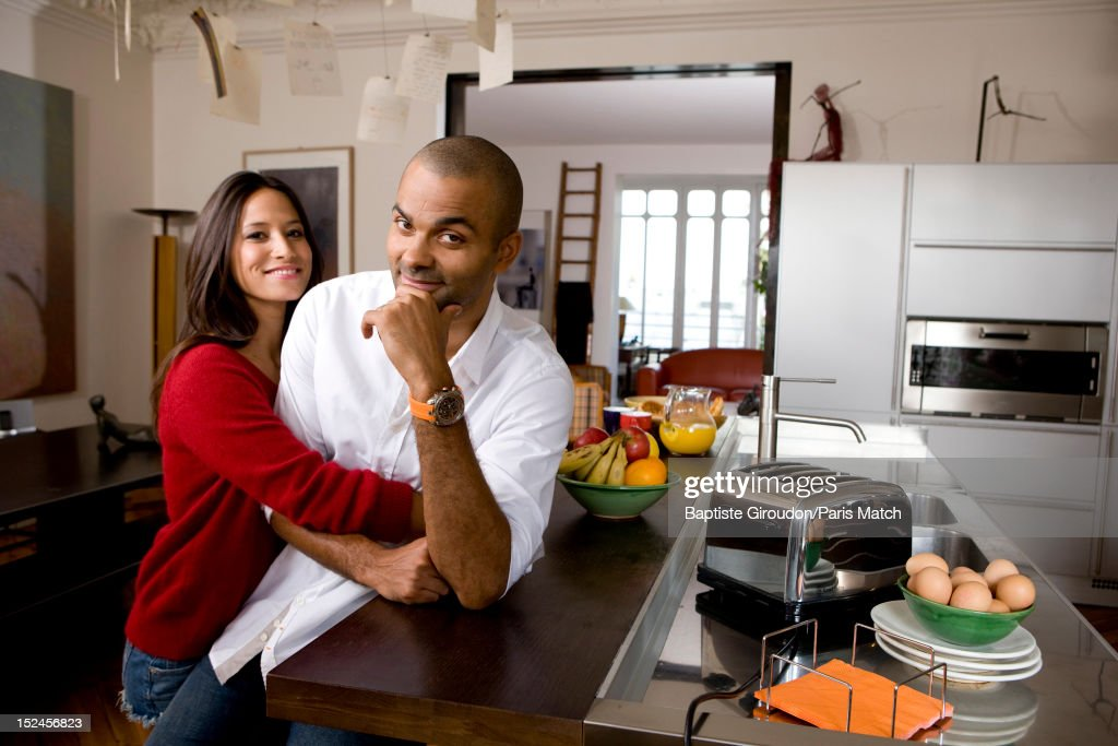 Basketball player Tony Parker and his fiance Axelle are photographed for Paris Match on September 10, 2012 in Paris, France.