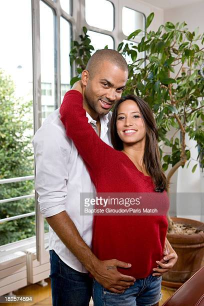 Basketball player Tony Parker and his fiance Axelle are photographed for Paris Match on September 10 2012 in Paris France