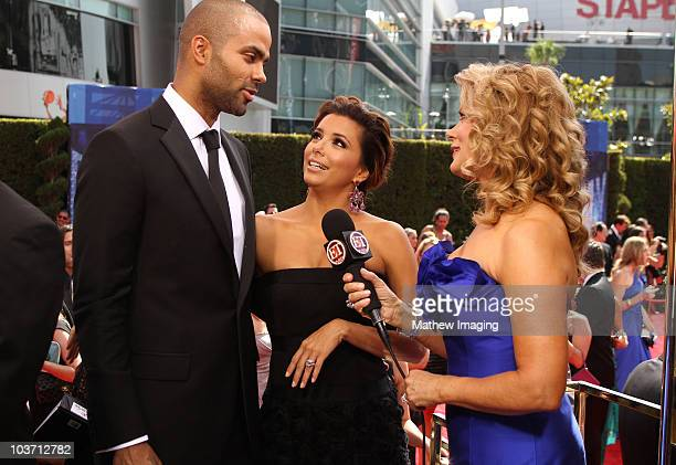 Basketball player Tony Parker and wife actress Eva Longoria Parker speak with TV personality Mary Hart at the ET Platform during the 62nd Annual...