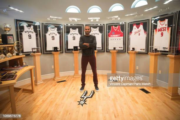 Basketball player Tony Parker in his trophy room in front of the four jerseys with which he won the title of NBA champion and those of his...