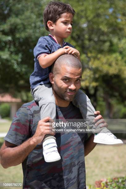 Basketball player Tony Parker with his son Josh are photographed for Paris Match at home on September 2 2018 in San Antonio United States