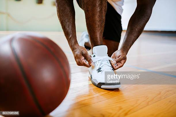 Basketball player tying up his shoelaces