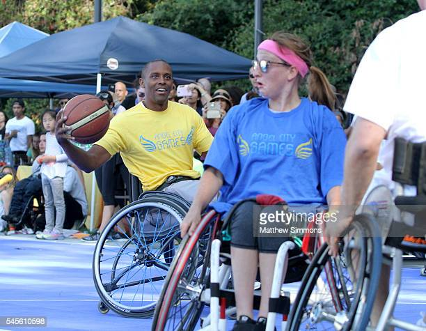 Basketball player Tyus Edney plays in a celebrity wheelchair basketball game during the 2nd Annual Angel City Games at UCLA's Drake Stadium on July...