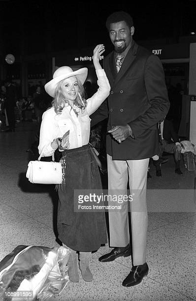 Basketball player Wilt Chamberlain and actress and model Vikki Dougan prepare to leave for Athens for the opening of Club Alexander in June 1969 in...