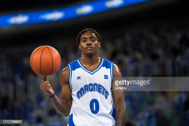 basketball player with ball - basketball uniform stock pictures, royalty-free photos & images