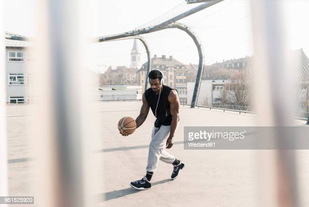 Basketball player with headphones in action on court
