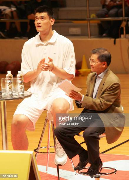 NBA basketball player Yao Ming attends a clinic for young players with AIDS researcher and scientist Dr David Ho in Hong Kong 22 September 2005 Yao...