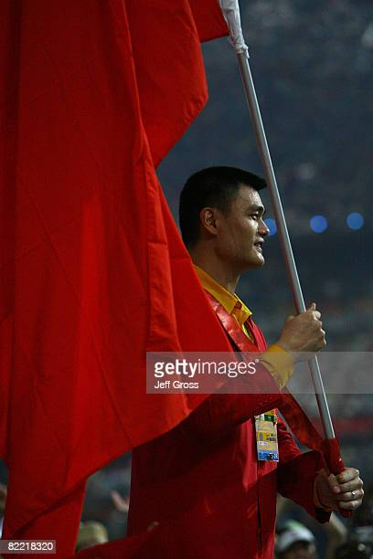 Basketball player Yao Ming of China carries his country's flag during the Opening Ceremony for the 2008 Beijing Summer Olympics at the National...