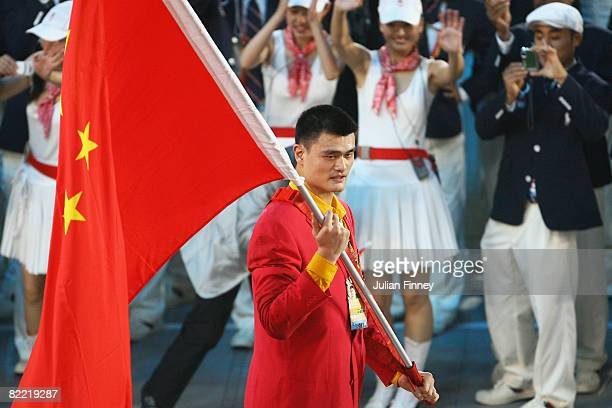 Basketball player Yao Ming of the Peoples Republic of China carries his country's flag during carries his country's flag during during the Opening...