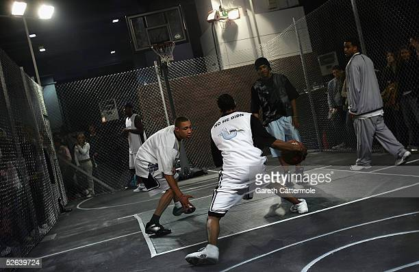 Basketball players are seen on the Nokia Streetball Court at the The Nokia Urban Music Festival With The Prince's Trust at Earls Court on April 16...
