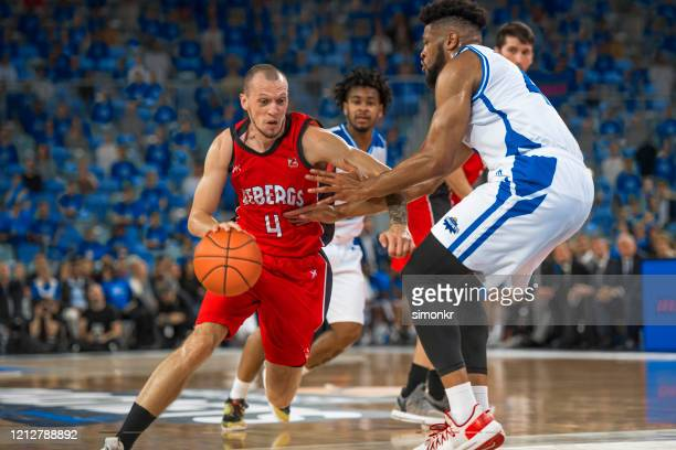 basketball players chasing for ball - basketball player stock pictures, royalty-free photos & images