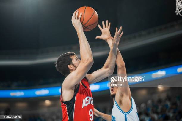 basketball players chasing for ball - basketball uniform stock pictures, royalty-free photos & images