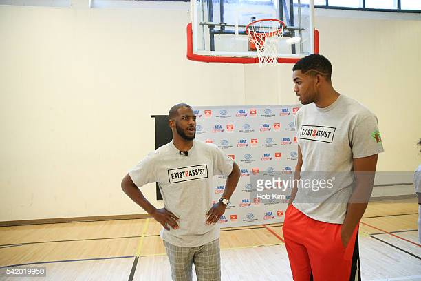 Basketball players Chris Paul and Karl-Anthony Towns attend a basketball clinic at Educational Alliance Boys & Girls Clubs - Edgies Clubhouse on June...