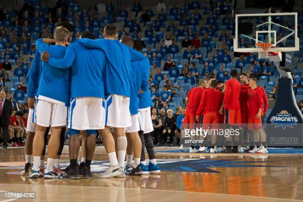 basketball players discussing strategy - basketball team stock pictures, royalty-free photos & images
