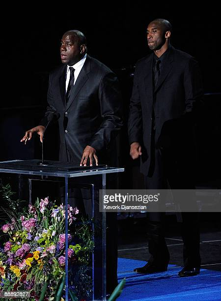 Basketball players Earvin Magic Johnson Jr and Kobe Bryant speak at the Michael Jackson public memorial service held at Staples Center on July 7 2009...