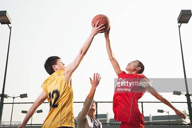 basketball players fighting for a ball - angriffsspieler stock-fotos und bilder