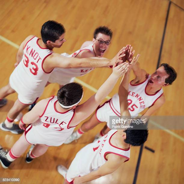 Basketball Players Huddling on Court