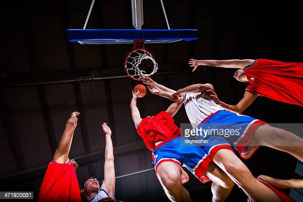 basketball players in action. - basketball team stock pictures, royalty-free photos & images
