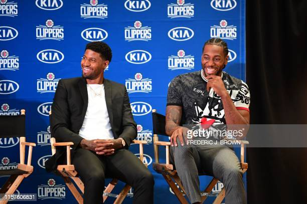 US basketball players Kawhi Leonard and Paul George are introduced as the new players of the Los Angeles Clippers during a press conference in Los...