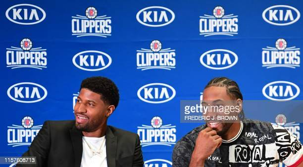 US basketball players Kawhi Leonard and Paul George react during a press conference to introduce them as the new players of the Los Angeles Clippers...