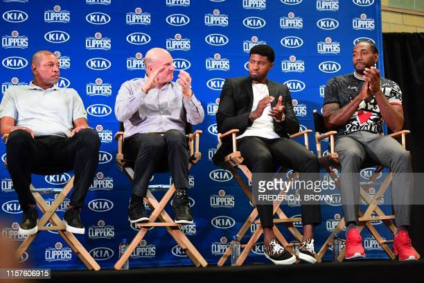 US basketball players Kawhi Leonard and Paul George sit next to Clippers coach Doc Rivers and Clippers owner Steve Ballmer during their introduction...