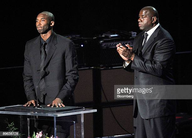 Basketball players Kobe Bryant left and Earvin Magic Johnson Jr speak during the memorial service for Michael Jackson at the Staples Center in Los...