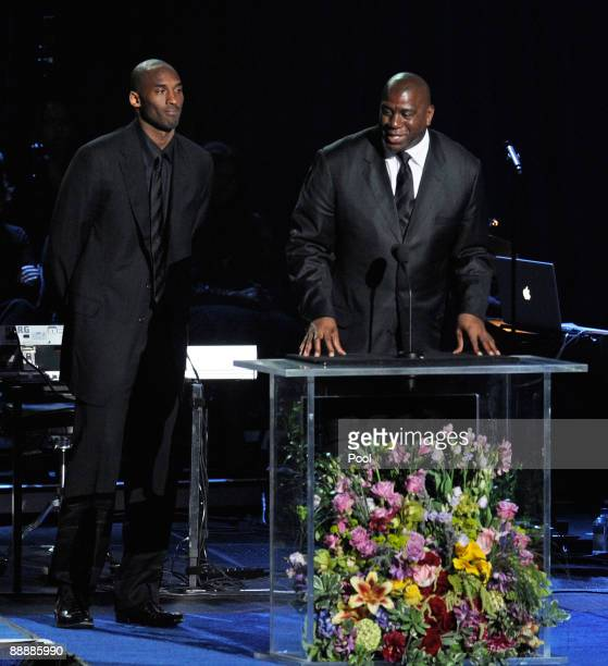Basketball players Kobe Bryant of the Los Angeles Lakers and Earvin Magic Johnson formerly of the Los Angeles Lakers speak at the Michael Jackson...