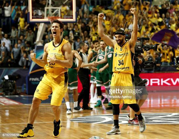 Basketball players of Iberostar Tenerife celebrate after their victory at the end of the FIBA Champions League final match between Iberostar Tenerife...