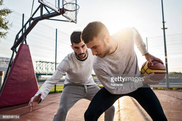 basketball players on court - blocking sports activity stock pictures, royalty-free photos & images