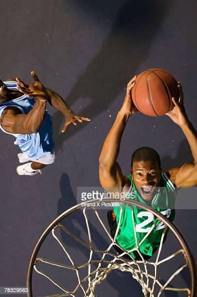 Basketball players playing a game