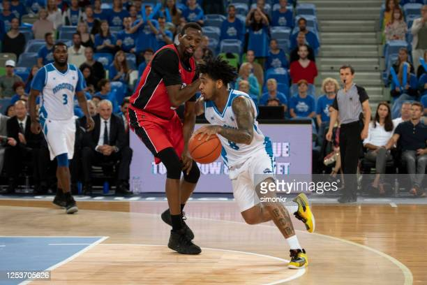 basketball players playing in court - referee stock pictures, royalty-free photos & images