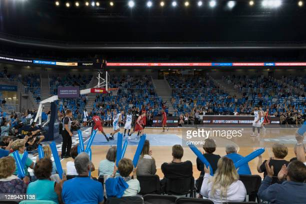 basketball players playing in court - basketball uniform stock pictures, royalty-free photos & images